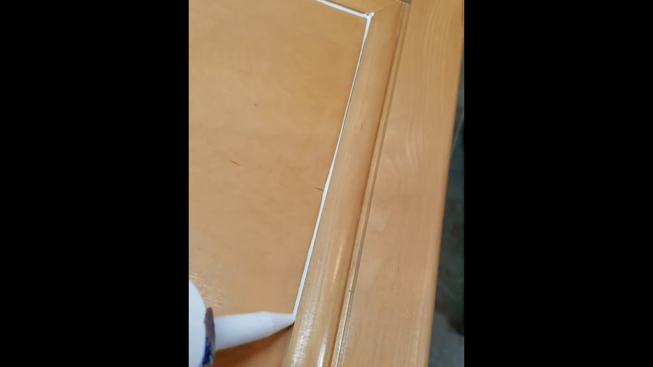 Caulking kitchen cabinets doors prior to painting. & Caulking kitchen cabinets doors prior to painting. - YouTube