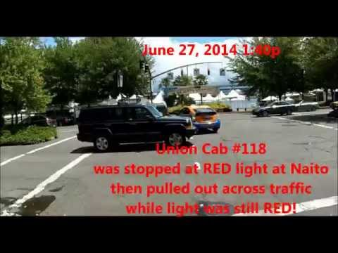 Union Cab 118 stops, then runs red light, SW Columbia & Naito