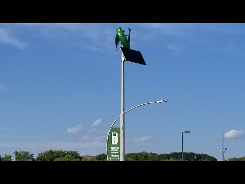 HYVEE STORES VERTICAL AXISWINDTURBINE WITH A SOLAR PANEL CHARGING STATIONS