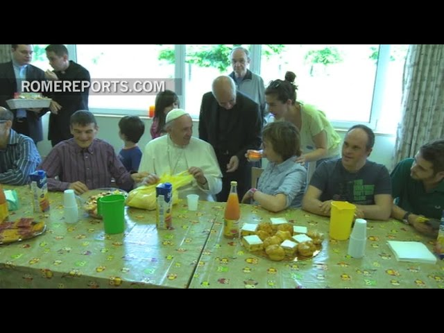 The Pope visits a center for the mentally disabled and shares a snack with them
