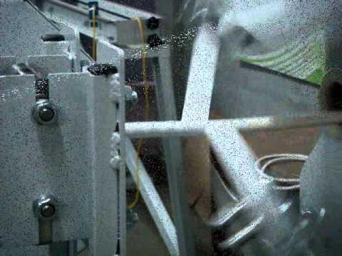 видео: Обмотка изоляции провода на станке АГОИ