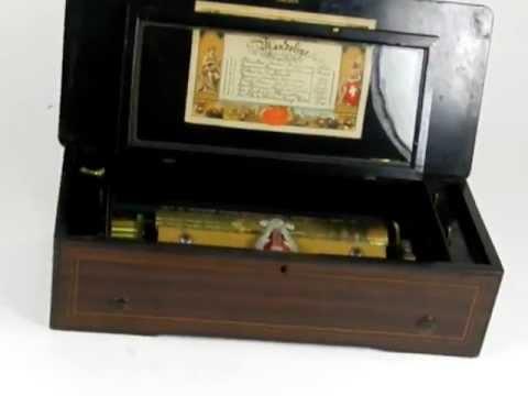 Caja de música antigua fabricada en Suiza en 1900. Con 8 melodías. Sonido Impecable.