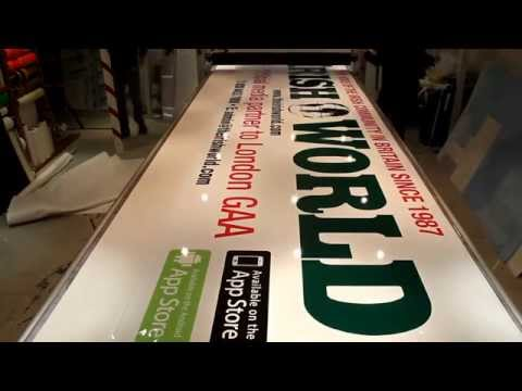 Laying up a 5m long printed vinyl sign onto foamex board