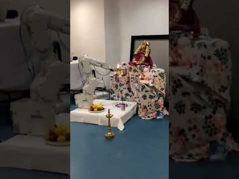 Robot Doing Aarti To Ganesh