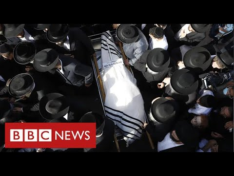 Funerals take place of Israelis crushed to death at religious festival - BBC News