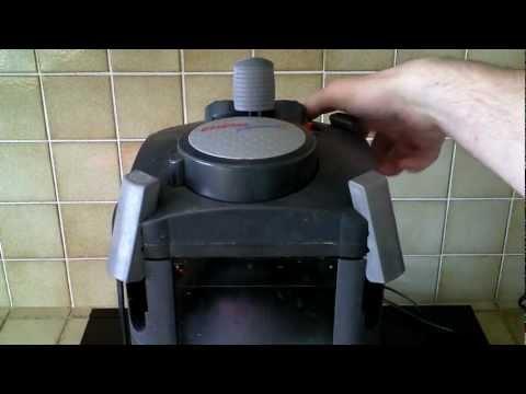 Cleaning an external Eheims 2 Pro filter and installing Purigen.mp4