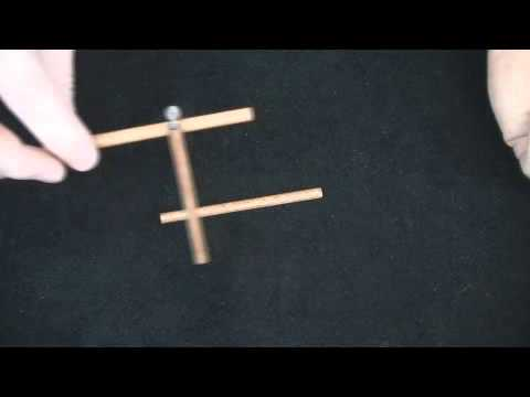Tripod Lift wood brain teaser puzzle - lift the tripod with just the stick