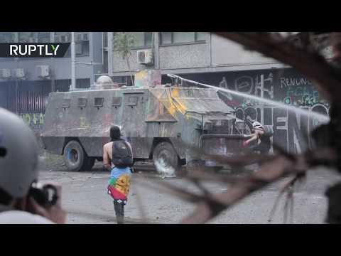 Mass protests grip Santiago as violent clashes erupt
