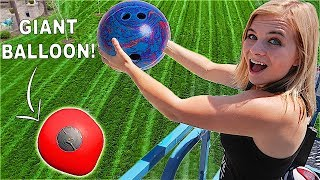 BREAKING OPEN GIANT WATER BALLOON! Bowling Ball vs Giant Balloon! (100ft DROP TEST!) // SoCassie