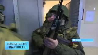 Russia Holds Snap Drills: Kremlin mobilizes ground and airborne forces to full combat alert