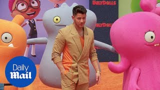 Nick Jonas is 'burnin' up' the carpet at UglyDolls premiere