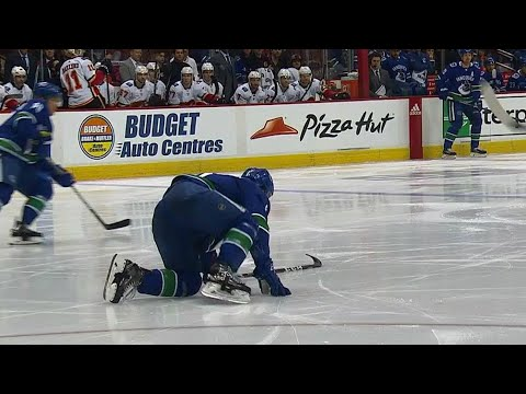 Boeser crawls & scrambles to bench after blocking hard shot with foot