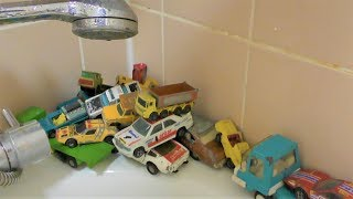 TOY CARS WASH IN THE BATHROOM UNDER THE SHOWER