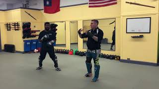 Sanda Kickboxing Techniques - Traditional concepts adapted to modern combat sport