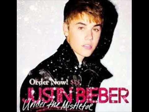 Christmas Eve  Justin Bieber under the mistletoe