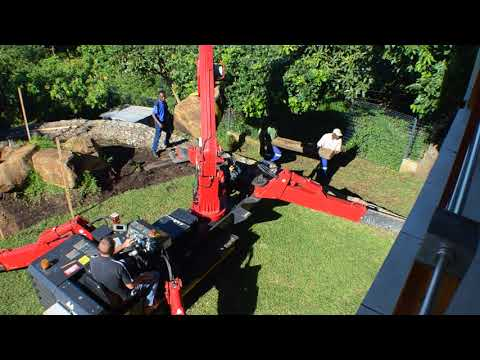 URW-547 Spider Crane Doing Heavy Landscape Work