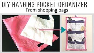 DIY hanging pocket organizer from shopping bags   DIY multipurpose organizer   best out of waste