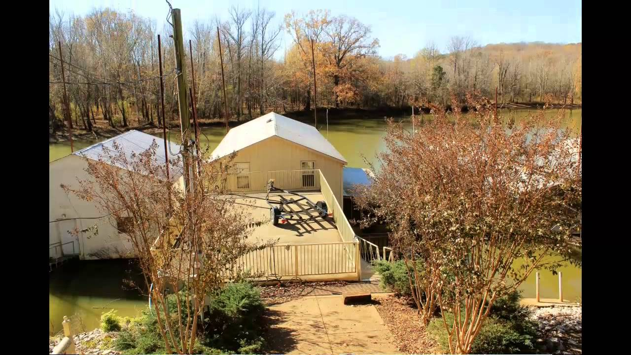 On the water living boat house garage w living for sale for Boat garage on water