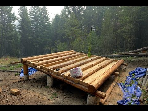 Off grid log cabin build floor construction youtube for How to build a cabin floor