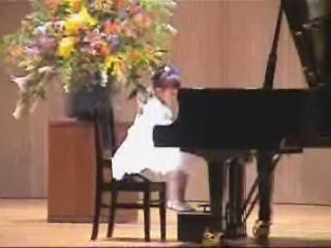 Aimi Kobayashi plays the piano at age of three