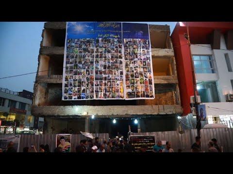 Iraqis mark first anniversary of devastating Baghdad blast