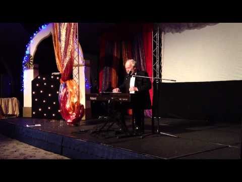 Sir Richard Stilgoe Entertains At The Caterham Winter Ball