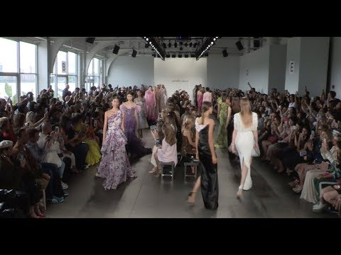 Models and designer on the runway for the Pamella Roland Fashion Show in NYC