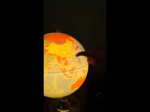 4 year Old Jackson showing us the countries of the world globe.