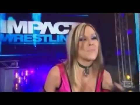 Velvet Sky pushes wheelchair of Karen Jarrett down the ramp of the TNA iMPACT Wrestling