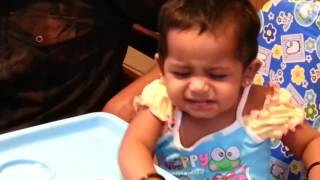One year old twins eating desserts in restaurant