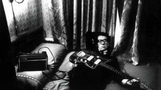 Watch Elvis Costello Strange video