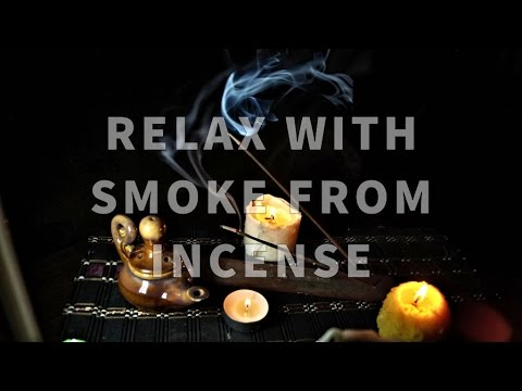 Relax with smoke from incense and ambient music. Meditation and relax