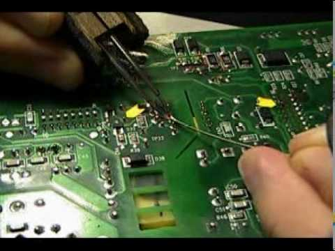 Through Hole Components Being Soldered To A Pcb Using