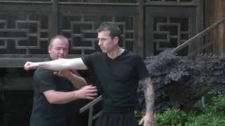 Sifu Burton and Master Yue teach the Five Thunder Dim Mak point Zhang Men