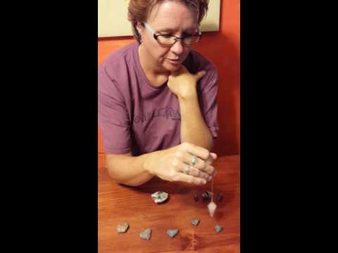 Darlene Garrison explains properties of garnets, which she encompasses in her jewelry creations for her business, Garnets in the Rough.