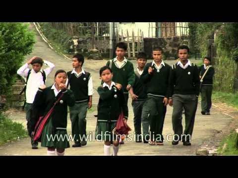 School kids in Cherrapunji carry their quintessential umbrellas