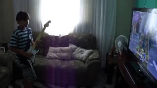 Marlon tocando Lego Rock Band guitarra xbox 360
