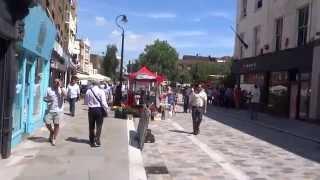 Walking through Lower Marsh Street Market on two separate hot summer days, Waterloo, London.