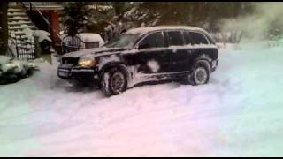 Volvo xc90 going up in heavy snow.