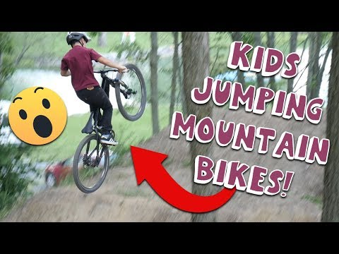 KIDS JUMPING MOUNTAIN BIKES