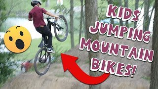 KIDS JUMPING MOUNTAIN BIKES