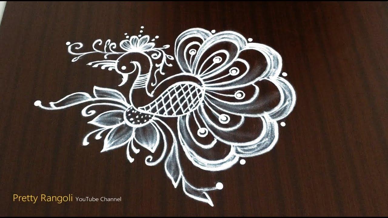 easy peacock rangoli/ simple freehand rangoli design*beautiful peacock kolam* alpona #349 #1