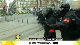 Yellow vest protests erupt again in Paris, as police fire tear gas