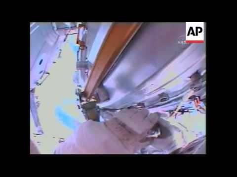 Astronauts wire up space station's newest room