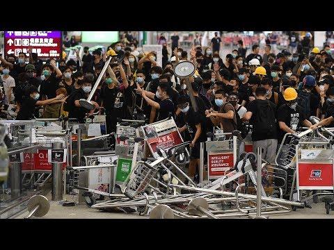 Violent protests at Hong Kong airport trigger public indignation