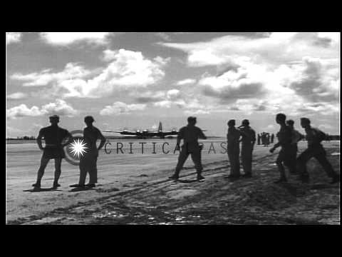 Airfield personnel watch as B-29 bomber lands on Isley Field base of US Army Air ...HD Stock Footage