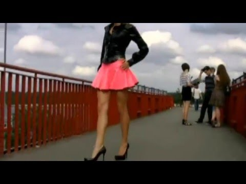 blond Girl in black latex blouse and pink latex Skirt