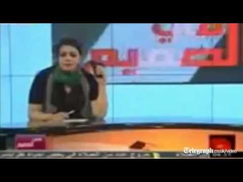 Libya conflict: TV presenter waves gun and threatens to become martyr