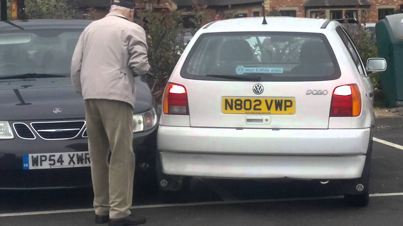 old person trying to reverse out of a parking space. - YouTube
