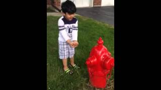 Vicku Explaining what this fire hydrant  is for